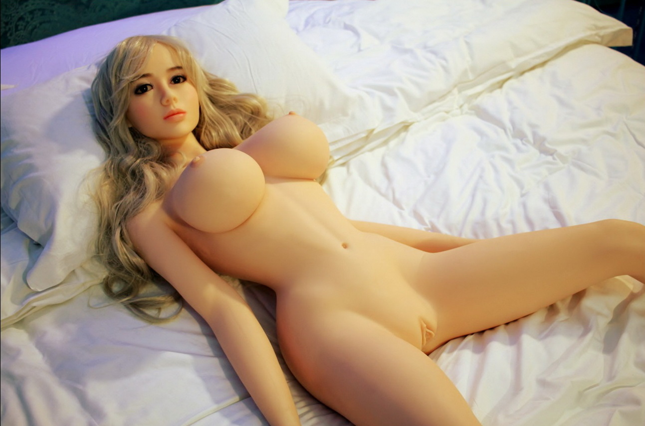 Girl masturbating with a barbie doll